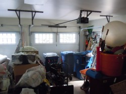 Once the stored items were moved in or donated, the garage bay closest to the fenced yard was chosen for the dogs.
